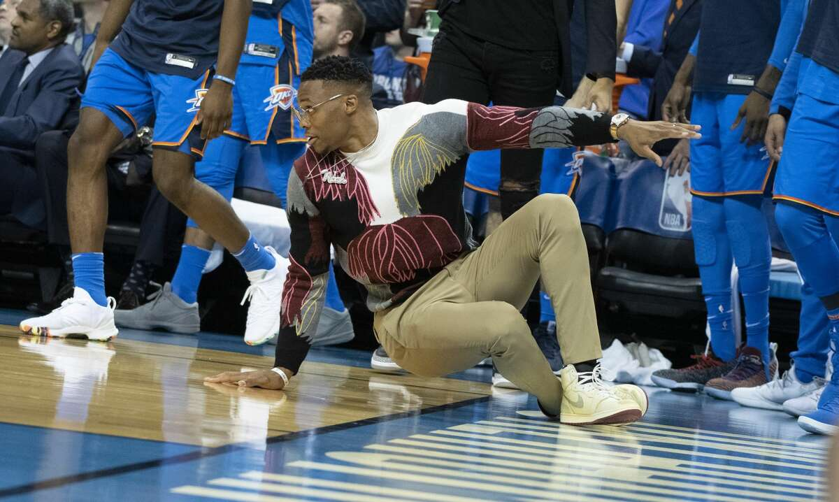 OKLAHOMA CITY, OK - NOVEMBER 8: An injured Russell Westbrook #0 of the Oklahoma City Thunder reacts during the second half of a NBA game against the Houston Rockets at the Chesapeake Energy Arena on November 8, 2018 in Oklahoma City, Oklahoma. NOTE TO USER: User expressly acknowledges and agrees that, by downloading and or using this photograph, User is consenting to the terms and conditions of the Getty Images License Agreement. (Photo by J Pat Carter/Getty Images)
