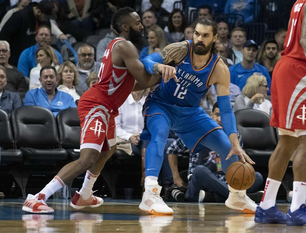 OKLAHOMA CITY, OK - NOVEMBER 8: James Harden #13 of the Houston Rockets and Steven Adams #12 of the Oklahoma City Thunder battle for positon during the second half of a NBA game at the Chesapeake Energy Arena on November 8, 2018 in Oklahoma City, Oklahoma. NOTE TO USER: User expressly acknowledges and agrees that, by downloading and or using this photograph, User is consenting to the terms and conditions of the Getty Images License Agreement. (Photo by J Pat Carter/Getty Images)