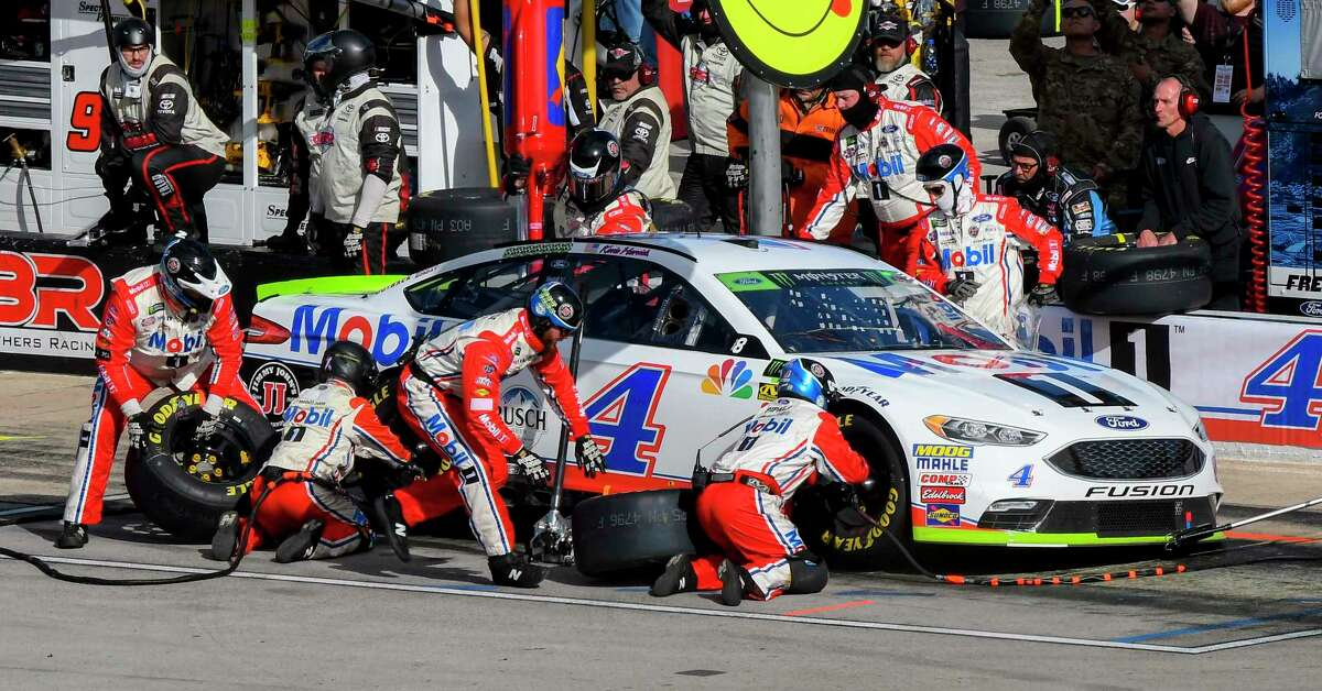 FILE - In this Sunday, Nov. 4, 2018, file photo, Kevin Harvick's pit crew services his car during the NASCAR Cup auto race at Texas Motor Speedway in Fort Worth, Texas. Harvick's bid for a second NASCAR title suffered a massive setback when he was stripped of his berth in the championship race after series inspectors found his winning car from Texas Motor Speedway had been deliberately altered to give him a performance advantage. (AP Photo/Larry Papke, File)