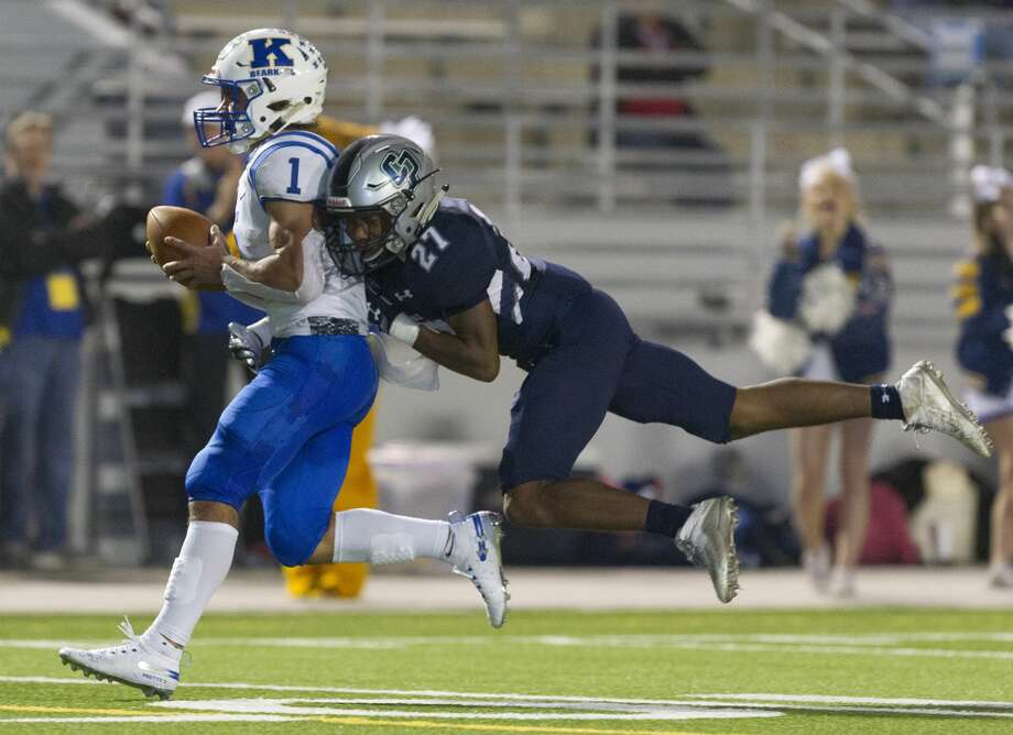 Klein wide receiver Tyson Thompson (1) gets College Park defensive back Curt Evangelister (27) for a 56-yard touchdown during the second quarter of a District 15-6A high school football game at Woodforest Bank Stadium, Thursday, Nov. 8, 2018, in Shenandoah. Thompson finished the half with three catches for 176 yards and three touchdowns. Photo: Jason Fochtman/Staff Photographer
