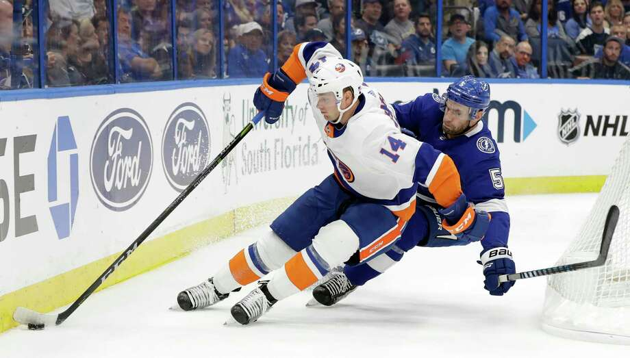 New York Islanders right wing Tom Kuhnhackl (14) gets around Tampa Bay Lightning defenseman Dan Girardi (5) during the first period of an NHL hockey game Thursday, Nov. 8, 2018, in Tampa, Fla. (AP Photo/Chris O'Meara) Photo: Chris O'Meara / Copyright 2018 The Associated Press. All rights reserved.