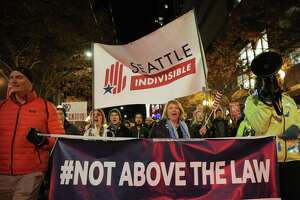 Several thousand demonstrators marched from Cal Anderson Park to the Federal Building downtown in support of the Mueller investigation and against President Trump's appointment of vocal investigation critic Matthew Whitaker as acting Attorney General, Nov. 8, 2018. This protest was in coordination with over 900 others across the nation.