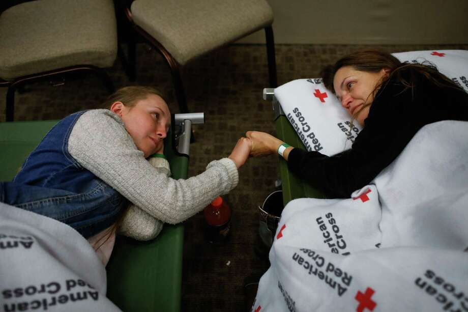 Evacuees Heidi Bigelow (right) and daughter Marina Joy Bigelow, 18 (left) who fled their home in Paradise, take a moment with each other at the Red Cross shelter in Chico, California, on Thursday, Nov. 8, 2018. Photo: Gabrielle Lurie / The Chronicle / ONLINE_YES