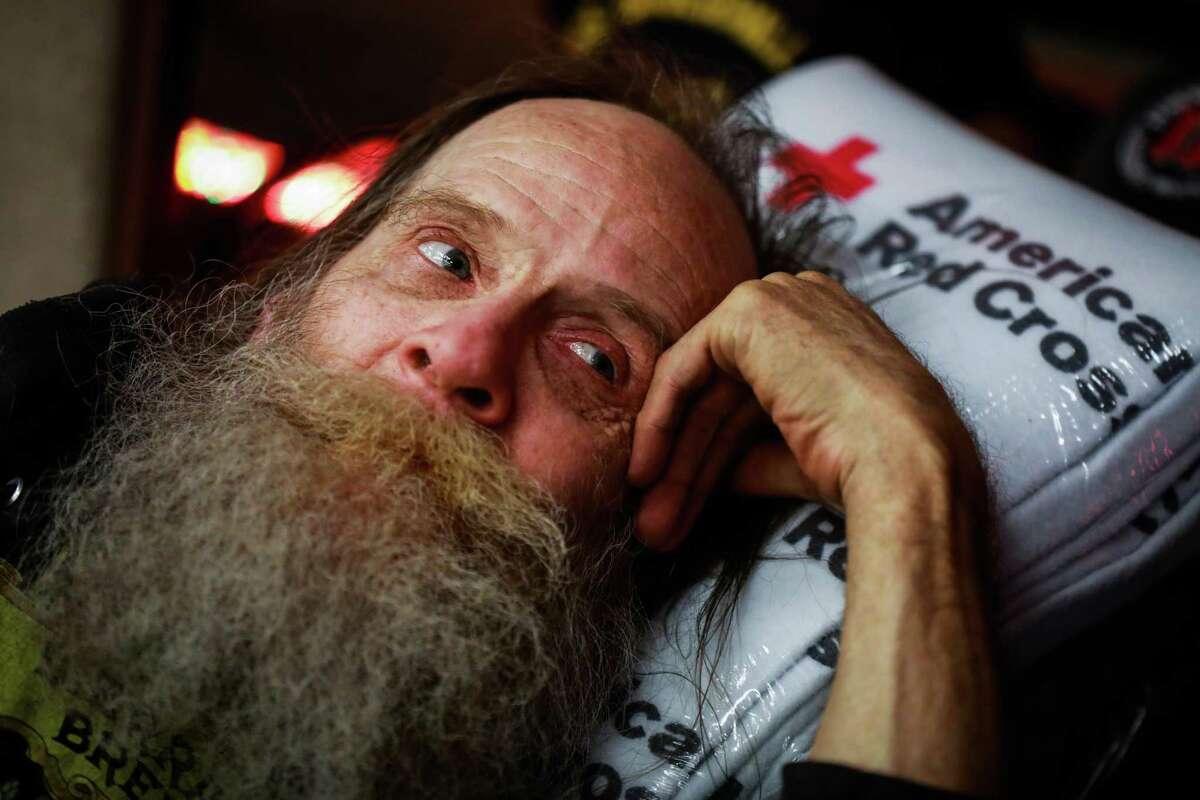 Evacuee John J. Underhill rests at the Red Cross shelter in Chico, California, on Thursday, Nov. 8, 2018.