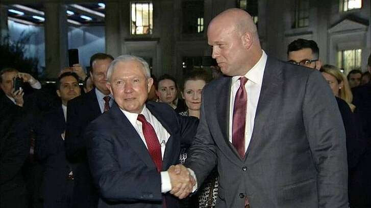 Former Attorney General Jeff Sessions shakes hands with his successor, Acting Attorney General Matthew G. Whitaker, an outspoken critic of the Mueller probe.