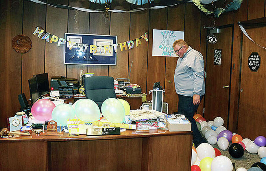 "Mayor Andy Ezard looks over his office Thursday after co-workers filled it and the hallways of the Jacksonville Municipal Building with balloons, streamers and photos of Ezard in recognition of his 50th birthday. Ezard said it was a great way to celebrate. ""The employees seemed pretty quiet this week,"" he said. ""We joke a lot on special events and I'm usually the instigator. They got me really good."" Photo: Samantha McDaniel-Ogletree 