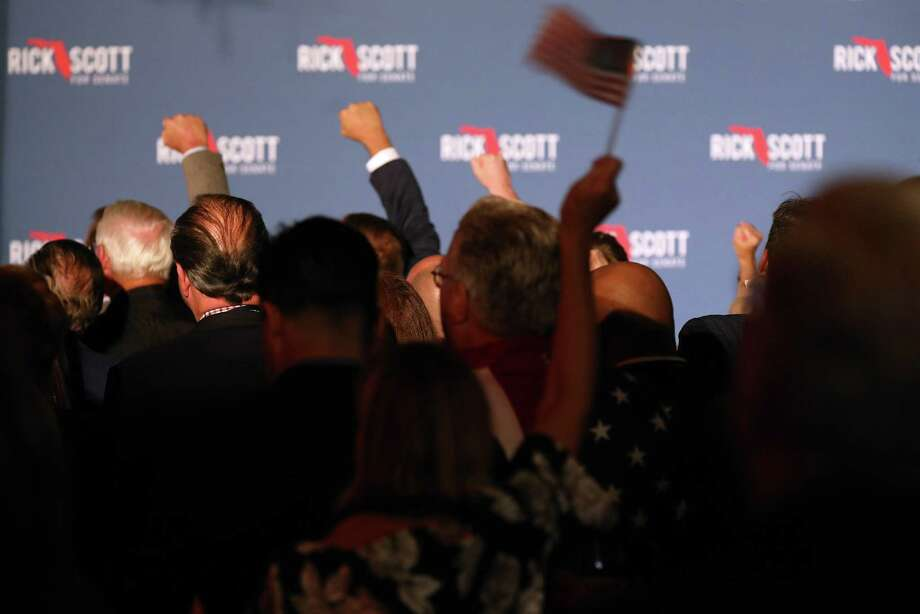 An election night rally for Rick Scott, governor of Florida and Republican U.S. Senate candidate, in Naples, Florida, on Nov. 6, 2018. Photo: Bloomberg Photo By Jayme Gershen. / © 2018 Bloomberg Finance LP