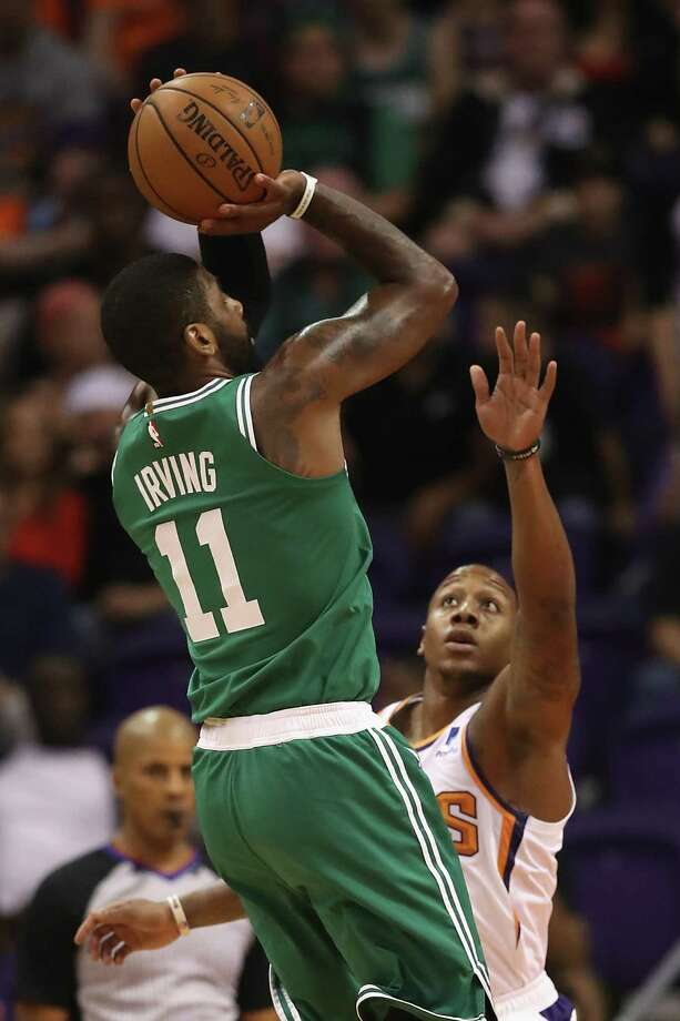 PHOENIX, AZ - NOVEMBER 08:  Kyrie Irving #11 of the Boston Celtics attempts a shot over Isaiah Canaan #0 of the Phoenix Suns during the first half of the NBA game at Talking Stick Resort Arena on November 8, 2018 in Phoenix, Arizona. NOTE TO USER: User expressly acknowledges and agrees that, by downloading and or using this photograph, User is consenting to the terms and conditions of the Getty Images License Agreement.  (Photo by Christian Petersen/Getty Images) Photo: Christian Petersen / 2018 Getty Images