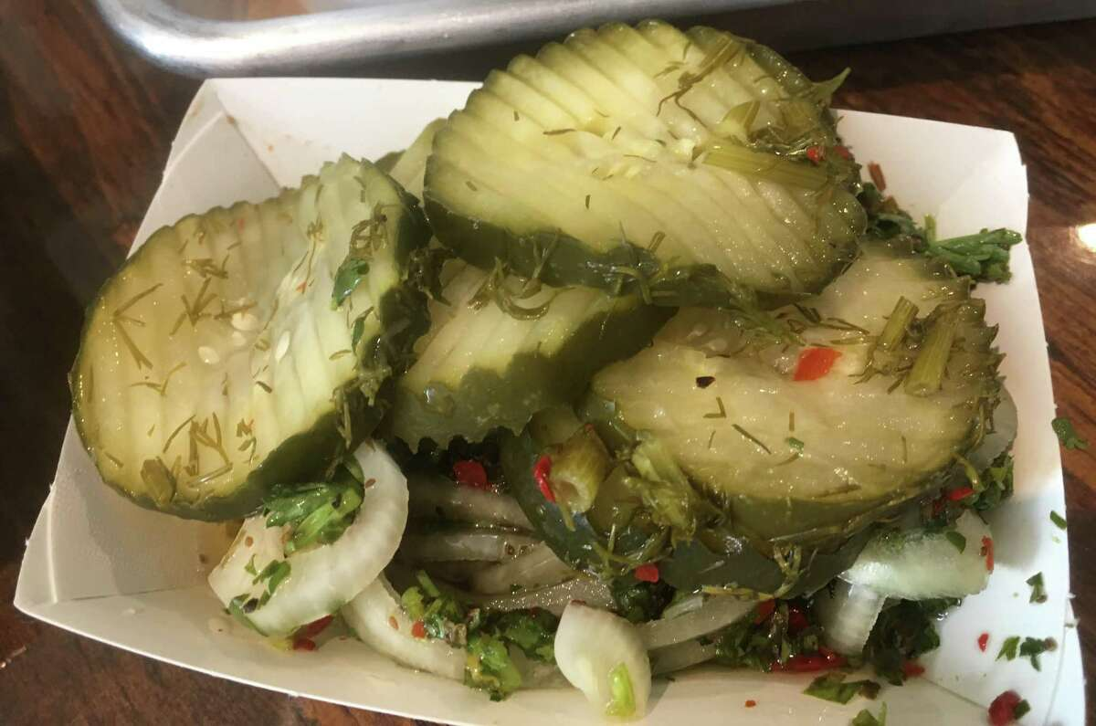 House-made pickles and onions at 2M Smokehouse are served complimentary.