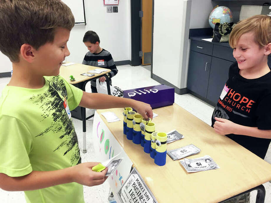 "Worden Elementary third-grade students Cooper Hammann and Coltin Hubbard work together during ""Market Day,"" as a curriculum experience where students further explored the concept of owning their own business. Photo: Julia Biggs 