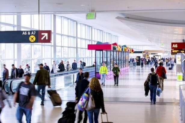 Passengers walk through Concourse A at Sea-Tac Airport.