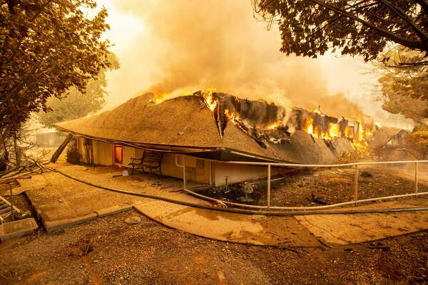 The Feather River Hospital burns down during the Camp fire in Paradise, California on November 8, 2018. - More than 18,000 acres have been scorched in a matter of hours burning with it a hospital, a gas station and dozens of homes. (Photo by Josh Edelson / AFP) (Photo credit should read JOSH EDELSON/AFP/Getty Images)