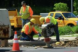 South Norwalk Electric and Water employees at work in June 2016 in Norwalk, Conn.