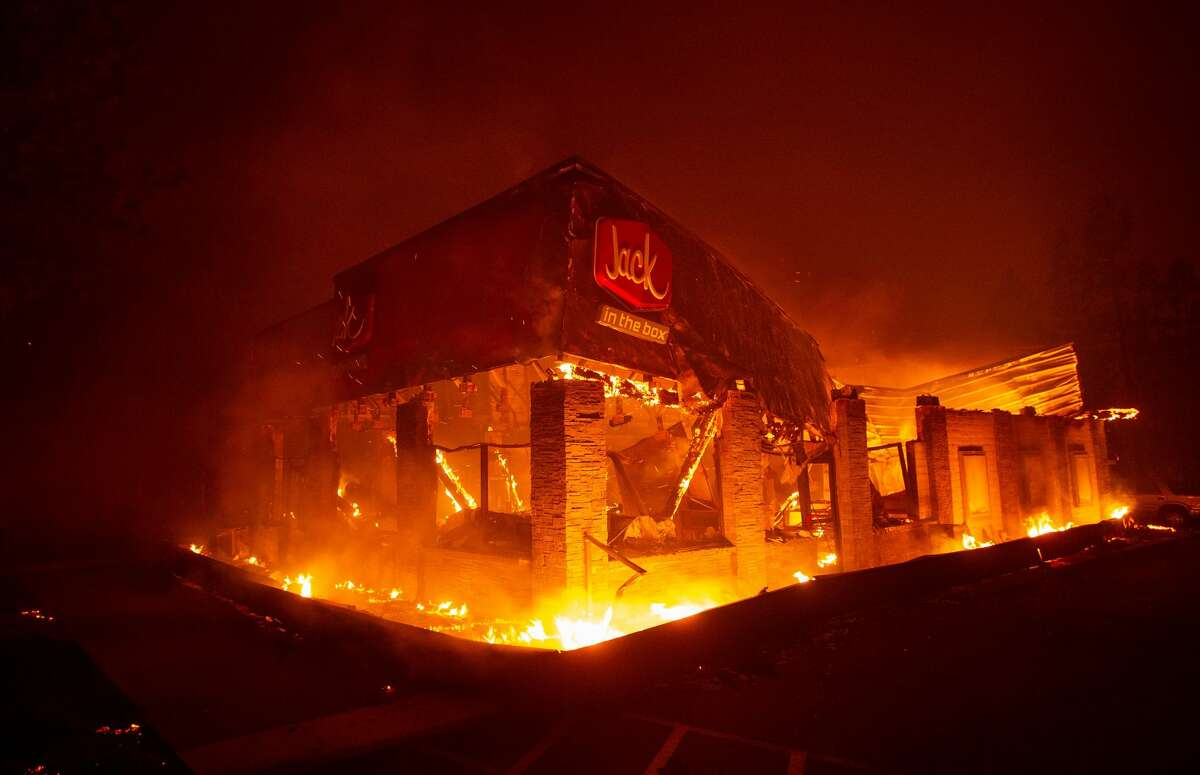 TOPSHOT - A Jack In The Box fast food restaurant burns as the Camp fire tears through Paradise, north of Sacramento, California on November 08, 2018. - More than one hundred homes, a hospital, a Safeway store and scores of other structures have burned in the area and the fire shows no signs of slowing. (Photo by Josh Edelson / AFP) (Photo credit should read JOSH EDELSON/AFP/Getty Images)