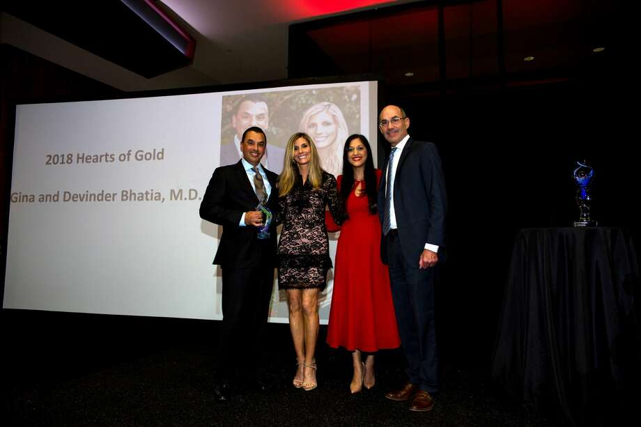 Dr. Devinder and Gina Bhatia onstage with Dr. Sippi Khurana and John Arcidiacono Photo: K. Gotham Photography