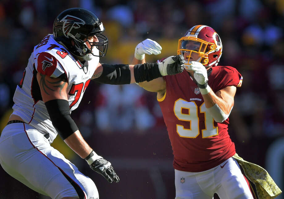 Falcons right tackle Ryan Schraeder draws several of the league's top pass rushers - like Redskins outside linebacker Ryan Kerrigan (91) - as assignments. Photo: Washington Post Photo By John McDonnell / The Washington Post