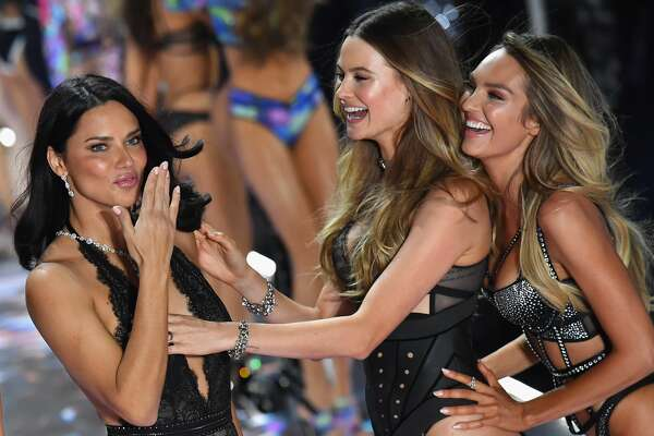 Models Adriana Lima, Behati Prinsloo, and Candice Swanepoel walk the runway at the 2018 Victoria's Secret Fashion Show on November 8, 2018 at Pier 94 in New York City. - Every year, the Victoria's Secret show brings its famous models together for what is consistently a glittery catwalk extravaganza. It's the most-watched fashion event of the year (800 million tune in annually) with around 12 million USD spent on putting the spectacle together according to Harper's Bazaar. (Photo by Angela Weiss / AFP) (Photo credit should read ANGELA WEISS/AFP/Getty Images)