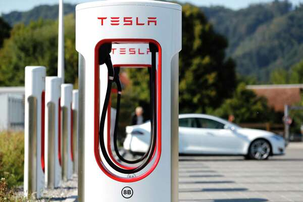 A Tesla Inc. Model S electric vehicle charges at a Supercharger station in Rubigen, Switzerland, on Aug. 16, 2018.