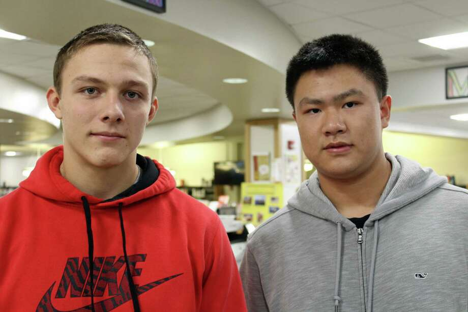 From left, Sergiy Babenkov (senior) and Haonan Zheng (junior). Photo: Humberto J. Rocha / Hearst Connecticut Media / New Canaan News