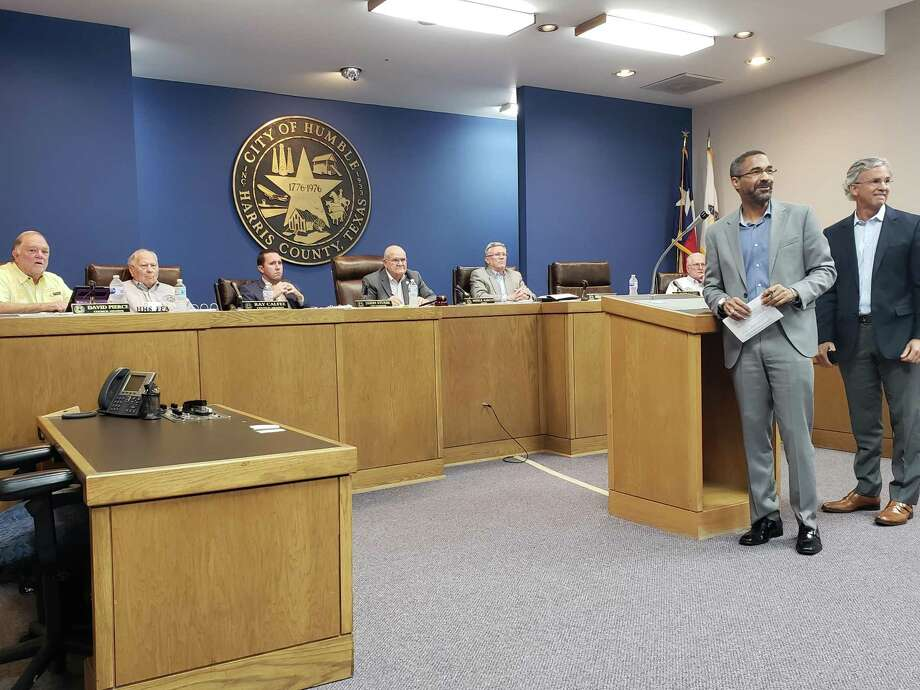 Mark Mitchell, president of the Lake Houston Area Economic Development Partnership and Eric Giesler with Economic Incentive Services await questions from the public regarding to nominate CDI Energy Products for the Texas Enterprise Zone Program. Photo: Kaila Contreras