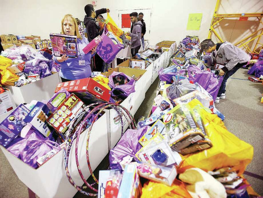 Volunteers last year sort through the hundreds of toys collected from the United Way of Greater St. Louis and The Telegraph's 28th annual Community Christmas drive at Main Street United Methodist Church. Photo: John Badman | The Telegraph
