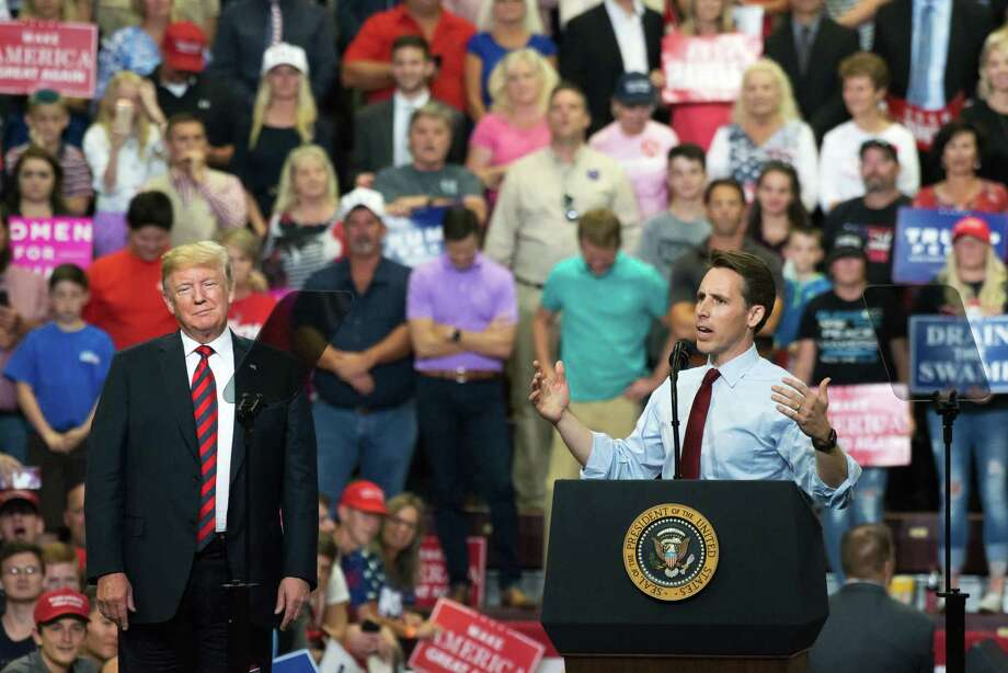Josh Hawley, right, Missouri Attorney General, is shown with President Donald Trump looks on during a rally for his Senate campaign in Springfield, Missouri, on Sept. 21, 2018. Hawley defeated Sen. Claire McCaskill, D. Photo: Bloomberg Photo By Neeta Satam / Bloomberg