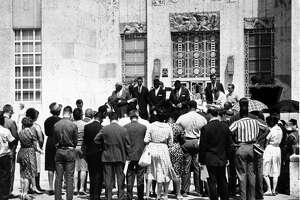 June 1963: About 100 people gather at the Houston City Hall steps to observe the 100th anniversary of the Emancipation Proclamation. T