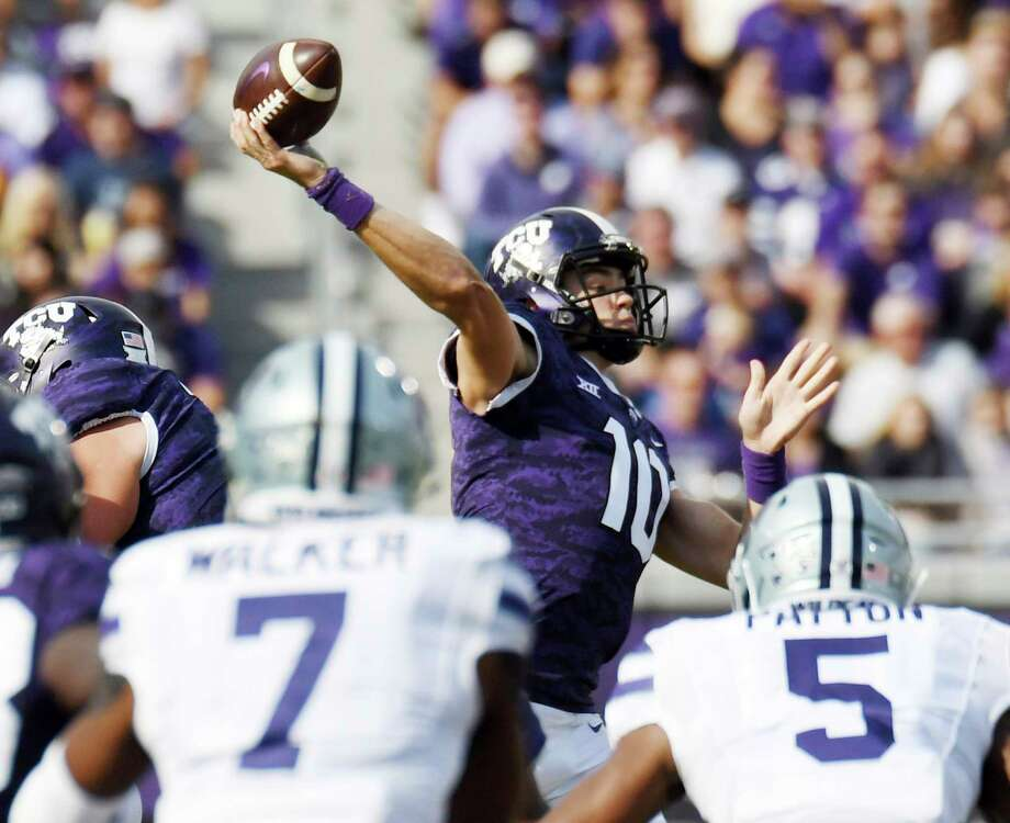PHOTOS:College football's largest stadiums in 2018 TCU quarterback Mike Collins(10) throws downfield against Kansas State during the second quarter of an NCAA college football game Saturday, Nov. 3, 2018, in Fort Worth, Texas. (Bob Haynes/Star-Telegram via AP) >>>Browse through the photos for a look at the biggest college football stadiums in 2018 ... Photo: Bob Haynes, Associated Press / FORT WORTH STAR-TELEGRAM