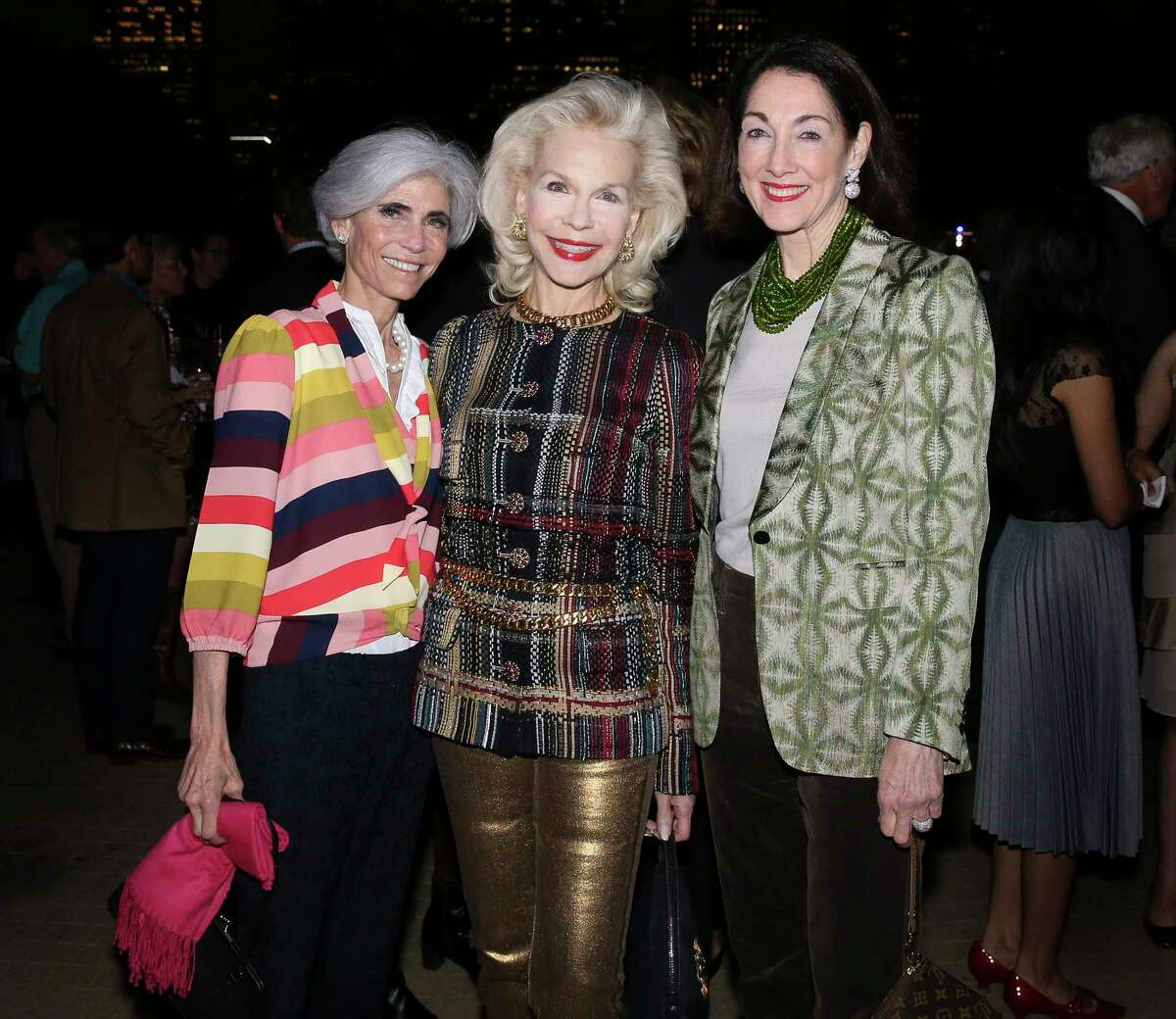 Honoree Judy Nyquist, from left, Lynn Wyatt and Suzie Criner pose for a photograph at the