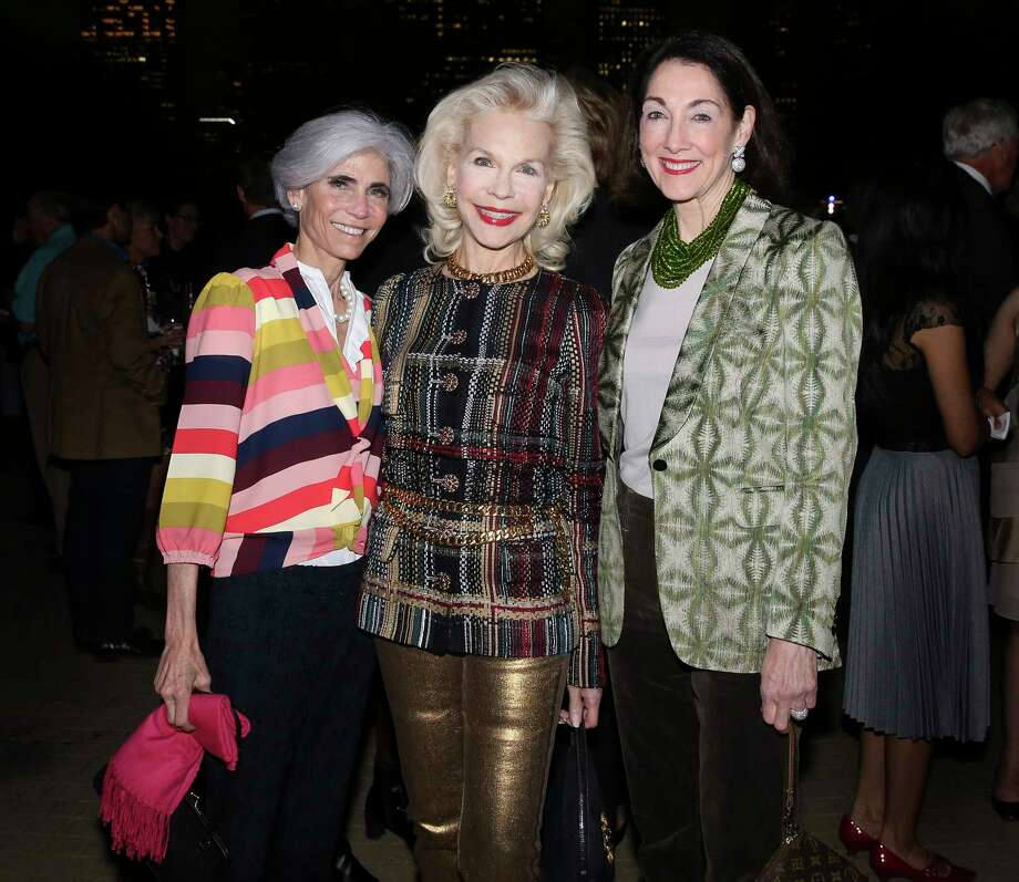 "Honoree Judy Nyquist, from left, Lynn Wyatt and Suzie Criner pose for a photograph at the ""Color Outside the Lines"" Buffalo Bayou Partnership Gala on Historic Sabine Street Bridge on Thursday, Nov. 8, 2018, in Houston. Photo: Yi-Chin Lee, Staff Photographer / © 2018 Houston Chronicle"