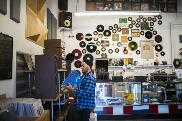 Sebastian Piedra works at the Heights Vinyl. The turntable repair and sales shop recently opened in the Fifth Ward.