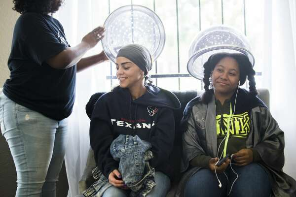 Sharlene Taylor, 29, and Keianna Randle, 16, both drive from outside the Fifth Ward to have their hair styled at the House of Style on Lyons Avenue.