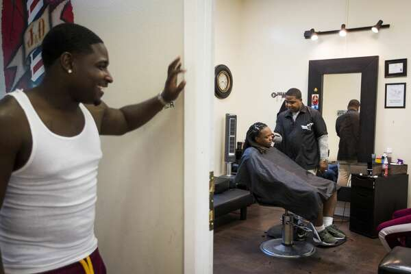 Obie Ridley co-owner of the J & O Barber Studio in the Fifth Ward works on a client.