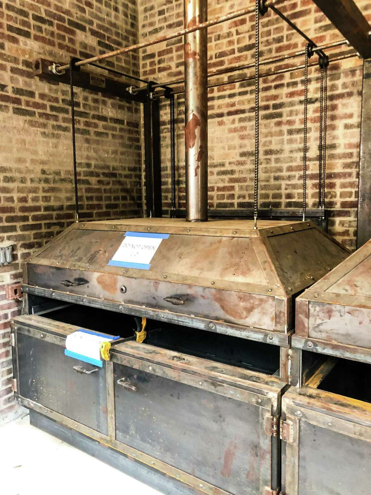 Custom-built whole-hog pits are under construction at Banger's Sausage House & Beer Garden in Austin.