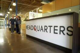 Peter, Mark and Devin Licata in the entry of Headquarters, the newest co-working space in Houston which takes advantage of an empty industrial building in the East End. Design is meant to be attractive to start-ups and younger employees.Photographed Thursday, Nov. 1, 2018, in Houston.