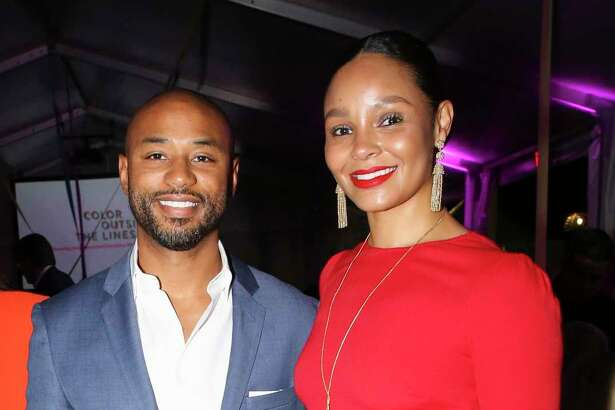 """Paul and Tanisha Canning pose for a photograph at the """"Color Outside the Lines"""" Buffalo Bayou Partnership Gala on Historic Sabine Street Bridge on Thursday, Nov. 8, 2018, in Houston."""