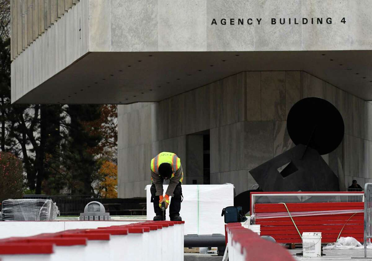 Mike Mike Agostine of Wynantskill with the Office of General Services assembles the Empire State Plaza ice rink for the season on Friday, Nov. 9, 2018, in Albany N.Y. (Will Waldron/Times Union)