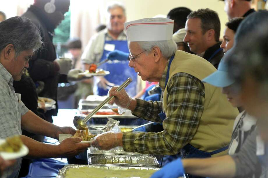 The 2017 Annual Community Thanksgiving Luncheon for the public at the Cornerstone Community Church, where all were treated to hot turkey, stuffing, potatoes, corn, cranberry sauce, gravy and more, plus pumpkin and apple pie for dessert. Photo: Alex Von Kleydorff / Hearst Connecticut Media / Norwalk Hour