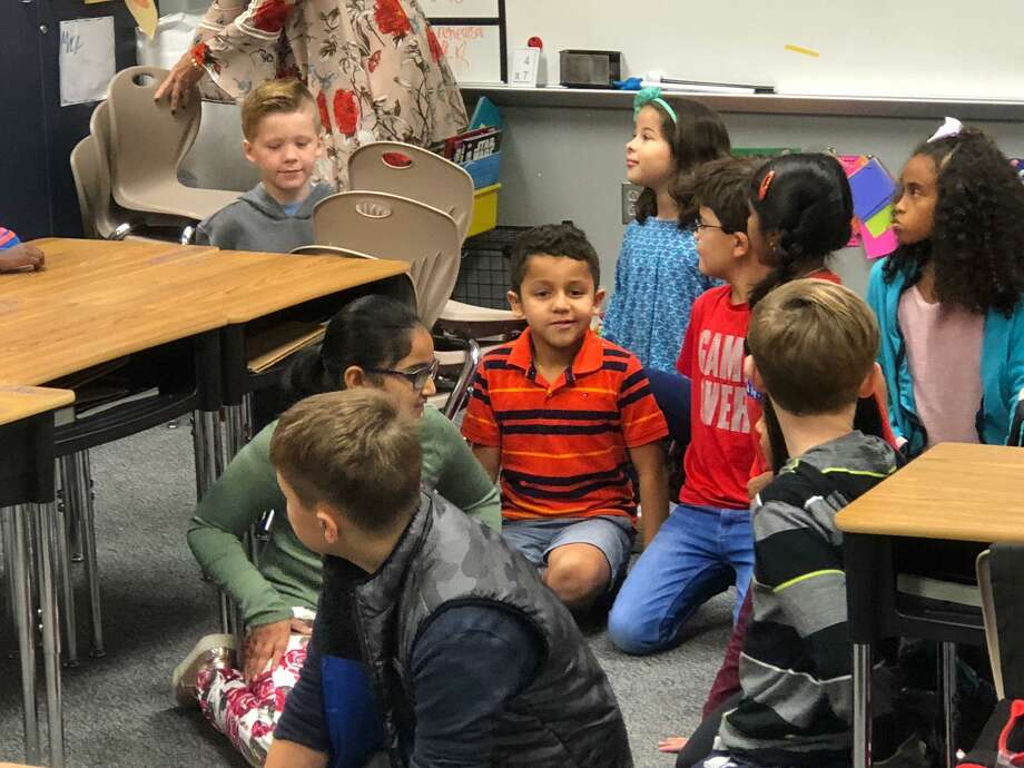 Christopher Morcos, 8, center with striped shirt, learns he is the 80,000th student in Katy ISD. A ceremony took place early Friday, Nov. 9, 2018, at Davidson Elementary School. Photo: Mike Glenn / Staff Photo