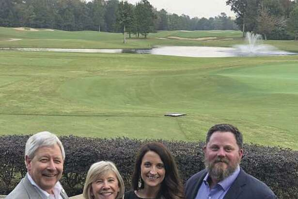 From left are Mark Woodroof and Marilyn Eiland, of BHGRE Gary Greene; Emily Wilcox and Blake Wilcox, of Blake Wilcox Properties LLC. Both companies announced the merger.
