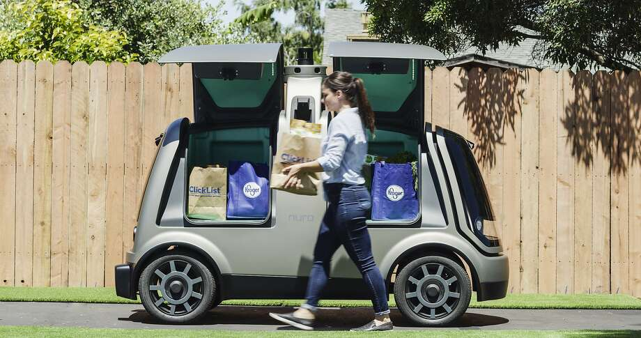 FILE - A handout photo shows a Nuro autonomous car filled with groceries. Domino's plans to test pizza delivery using fully autonomous vehicles in Houston. Photo: Nuro