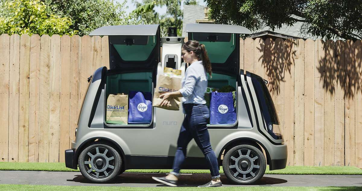 FILE - A handout photo shows a Nuro autonomous car filled with groceries. Domino's plans to test pizza delivery using fully autonomous vehicles in Houston.