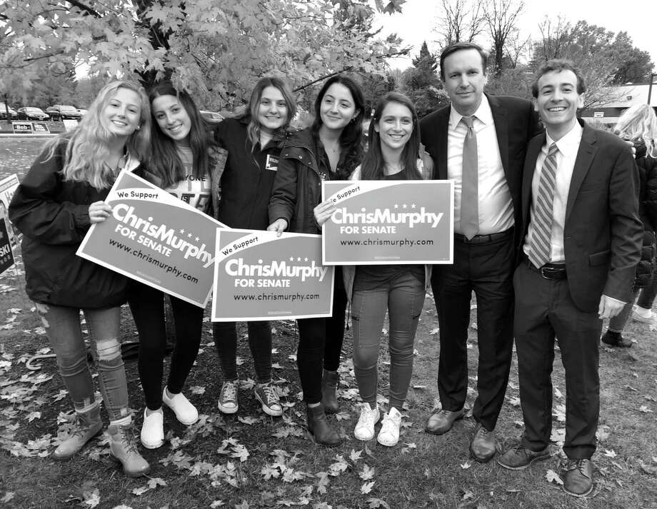 Supporters of Will Haskell and Senator Chris Murphy stand with the candidates outside the polling place at Long Lots Elementary School on Election Day, Nov. 6. Photo: Sophie Vaughan / Hearst Connecticut Media / Westport News