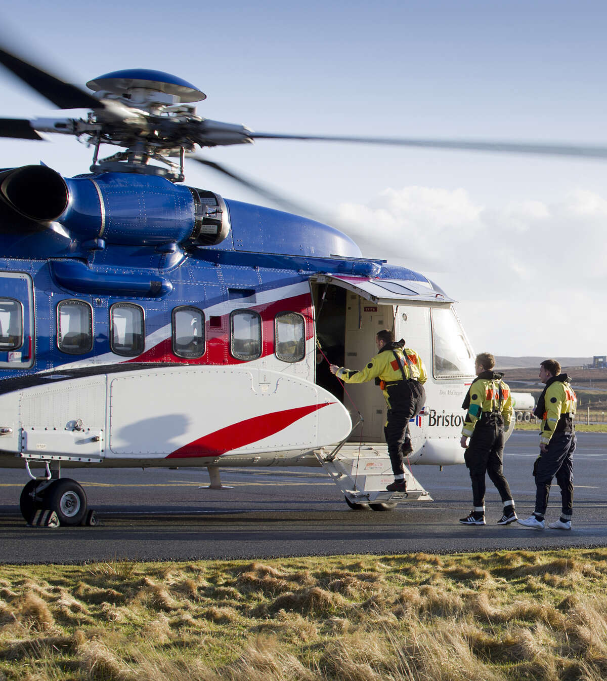 People boarding a Bristow Group helicopter.
