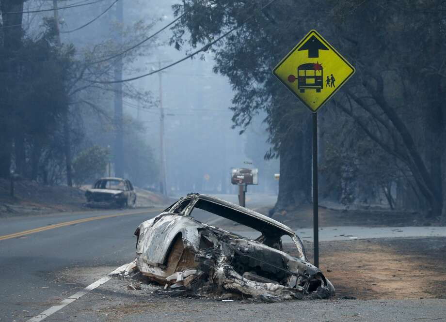 An abandoned vehicle sits in a ditch on Pentz Road in Paradise, Calif., Thursday, November 8, 2018, after the neighborhood was evacuated in the wake of the Campfire. Photo: Digital First Media/The Mercury /Digital First Media Via Getty Im