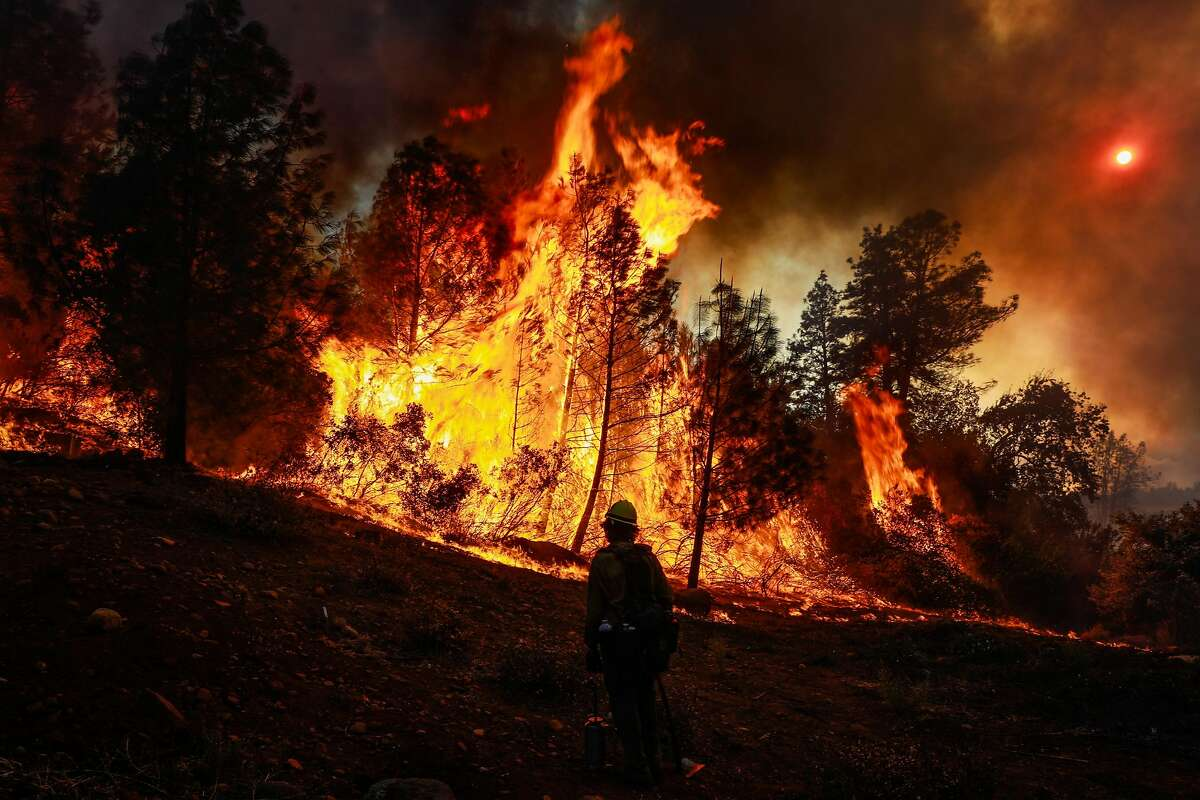 A hotshot crewmember watches as the Camp Fire burns off of Pentz Road in Paradise, California, on Thursday, Nov. 8, 2018.