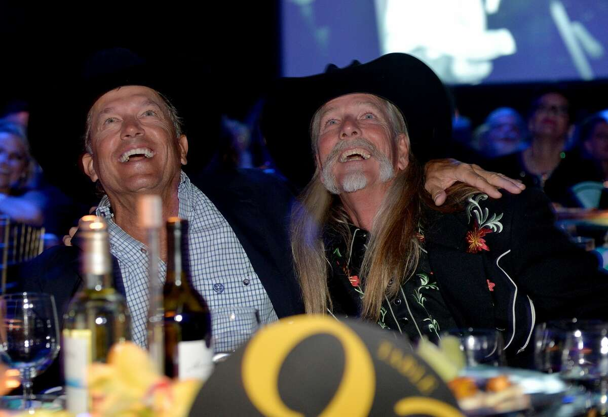 PHOTOS: The people who have written George Strait's biggest songs George Strait (L) and Honoree Dean Dillon attend the 61st annual BMI Country Awards on November 5, 2013 in Nashville, Tennessee. >>>See the other songwriters that King George has used to craft his biggest hits...