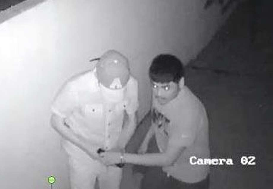 Laredo police need to identify these two men who allegedly jumped a fence and entered a shed in an east Laredo property. Photo: Courtesy Laredo Police Department