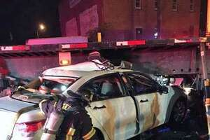 Bridgeport, Conn., firefighters freed someone trapped in their car under a tractor trailer's flatbed on Nov. 3, 2018.
