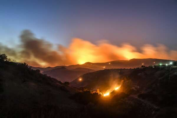 THOUSAND OAKS, CA - NOVEMBER 08: The Hill Fire burns in the hills west of Conejo Center Drive in Thousand Oaks, CA, on Thursday, Nov 8, 2018. (Photo by Jeff Gritchen/Digital First Media/Orange County Register via Getty Images)